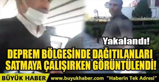 deprem_bolgesinde_dagitilanlari_satmaya_calisirken_goruntulendi_h25806